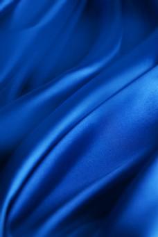 化妆品背景蓝色丝绸丝质背景